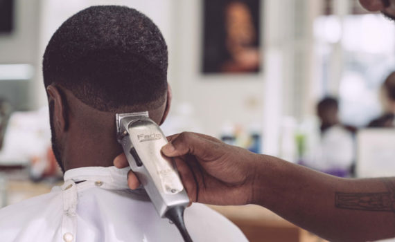A man is attended to at a barbershot