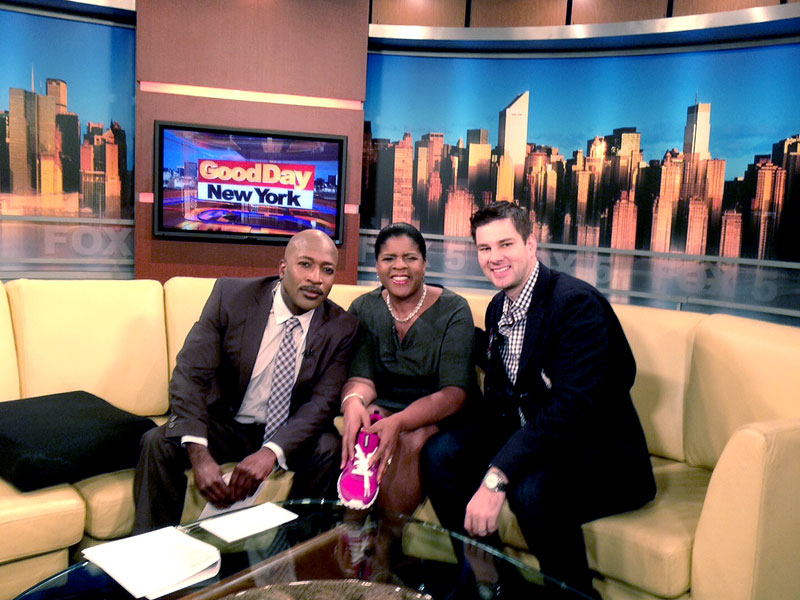 Ruth Browne (holding a pink athletic shoe) joins Antwan Lewis on Good Day New York